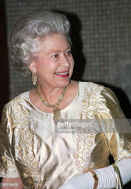 Happy And Smiling At Her Golden Wedding Anniversary Party The Queen Attending 'the Royal Gala' At The Festival Hall In London Chose A Gold Evening...