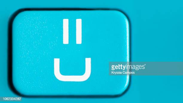 happy anthropomorphic face key on calculator key - fun calculator stock photos and pictures