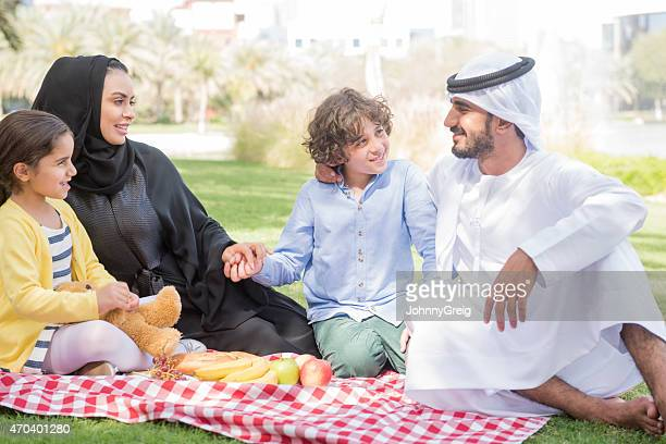 Happy Arab family on picnic outdoors