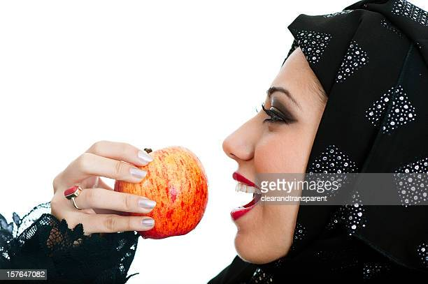 happy arabic girl eating an apple - beautiful arab girl stock photos and pictures