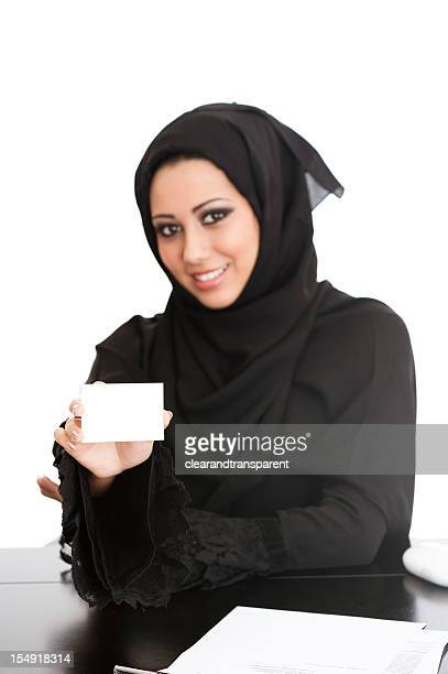 happy arabic girl holding card - beautiful arab girl stock photos and pictures