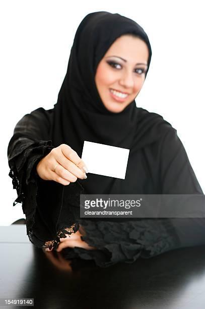 Happy Arabic girl holding card