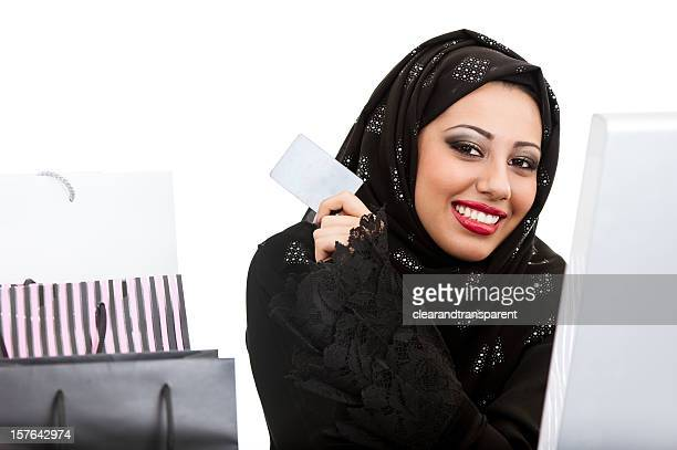 Happy Arabic girl shopping on the internet