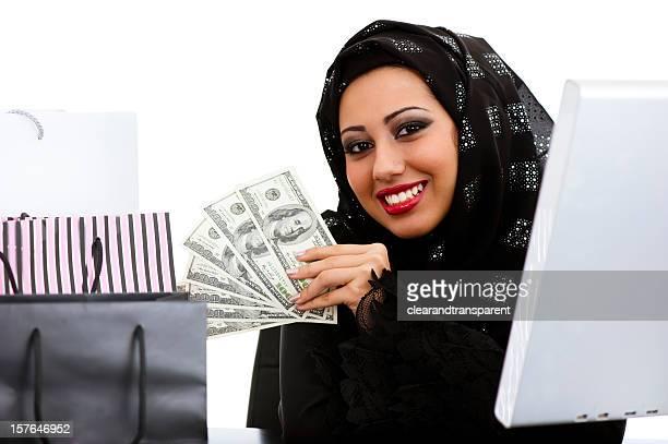 Happy Arabic girl shopping on the internet