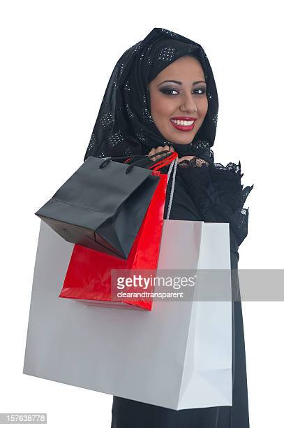 happy arabic girl shopping - beautiful arab girl stock photos and pictures