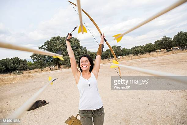 happy archeress on sports field - dog knotted in woman stock pictures, royalty-free photos & images