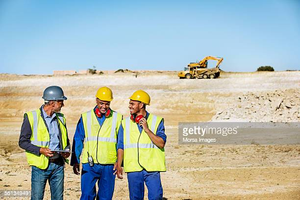 Happy architects and workers on quarry