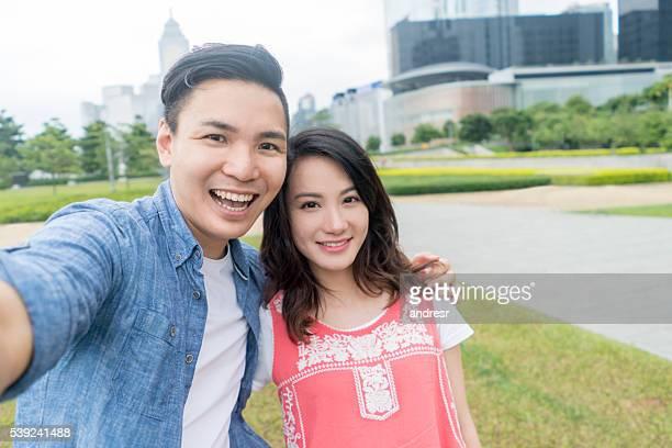 Happy Asian couple taking a selfie