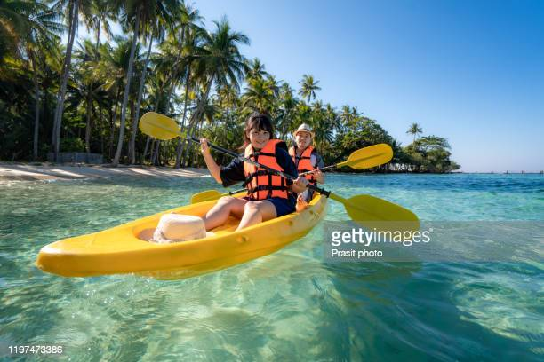 happy asian couple to play kayak in the blue lagoon ocean sea in koh kood island in trat, thailand.  water travel adventure tourism destination place asia, summer holiday vacation trip - kayak stock pictures, royalty-free photos & images