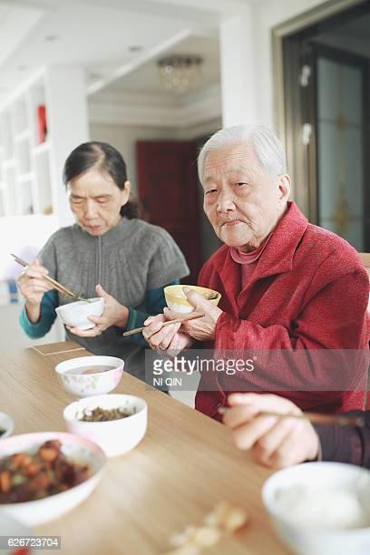 Happy Asian family enjoying lunc