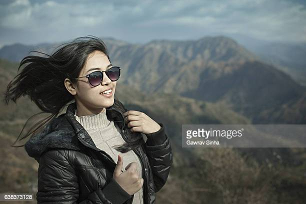 Happy Asian girl in mountains.