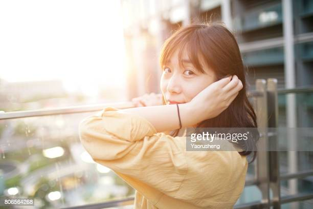 Happy asian girl in sunset with smile