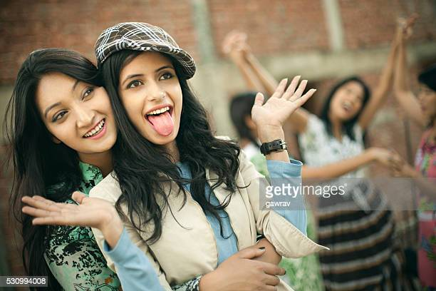 Happy Asian girls playing together and having fun in outdoor.