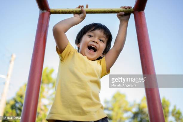 happy asian japanese little boy playing in playground with yellow t-shirt - preschool child stock pictures, royalty-free photos & images