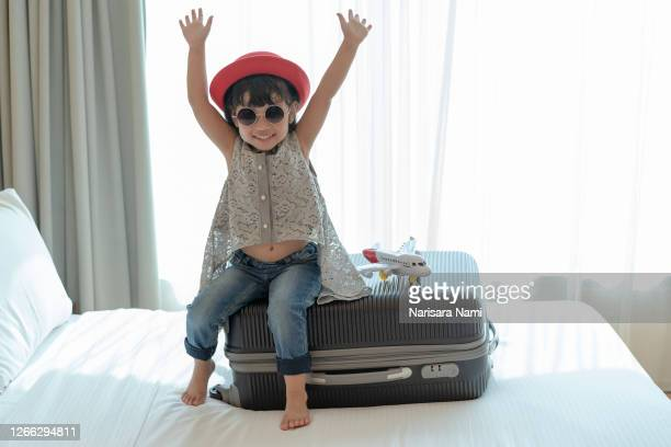happy asian kid child girl playing with toy airplane. travel, tourism and tourist concept. - toddler at airport stock pictures, royalty-free photos & images