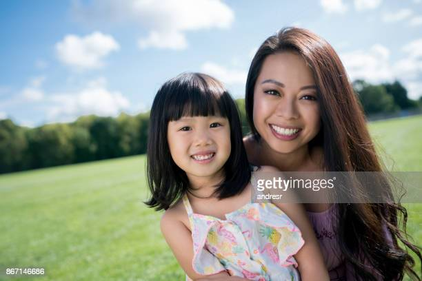 happy asian mother and daughter at the park - beautiful chinese girls stock photos and pictures