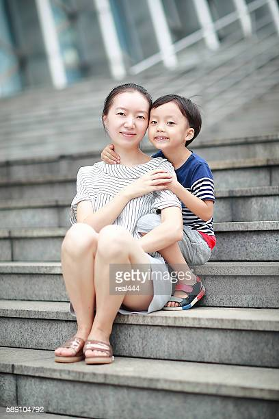 Happy Asian mother and son