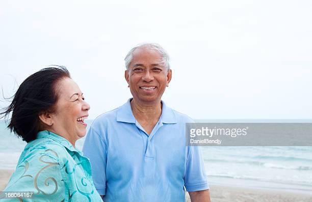 Happy Asian Retiree Couple Having Good Time on Beach