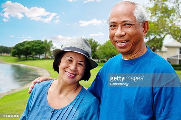 Happy Asian Retiree Couple Smiling