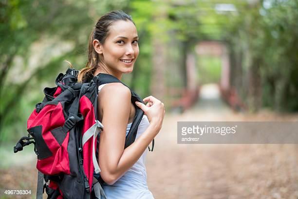 Happy Asian woman hiking