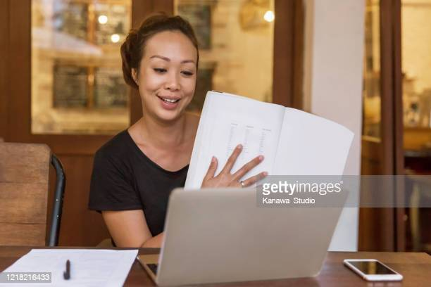 happy asian woman teaching online class from home during covid 19 pandemic - teaching stock pictures, royalty-free photos & images
