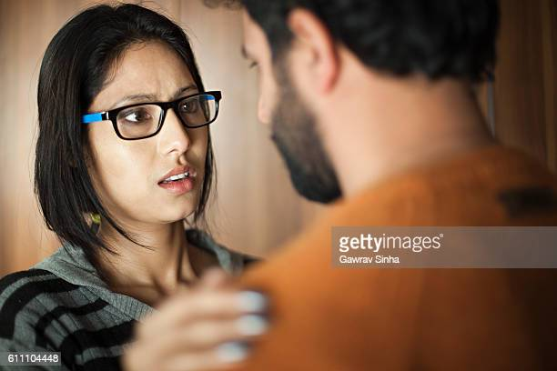happy asian young man and woman talking face to face. - husband stock pictures, royalty-free photos & images