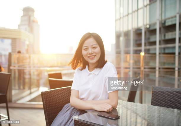 Happy asian young woman smile  in sunset