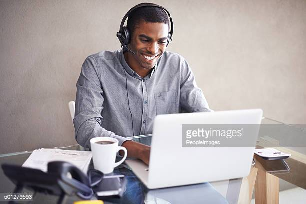 happy at his home workstation - headset stock pictures, royalty-free photos & images