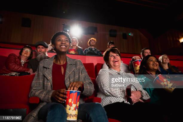 happy at the movies - film screening stock pictures, royalty-free photos & images