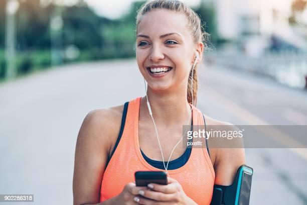 Happy athlete listening music