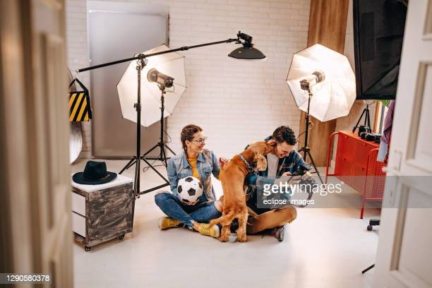 happy atmosphere in photo studio - photo shoot stock pictures, royalty-free photos & images