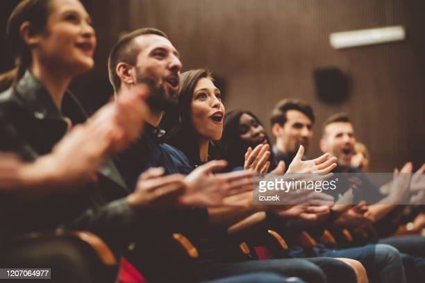 happy audience applauding in the theater - izusek stock pictures, royalty-free photos & images