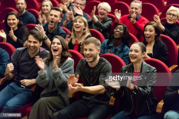 happy audience applauding in the theater - comedian stock pictures, royalty-free photos & images