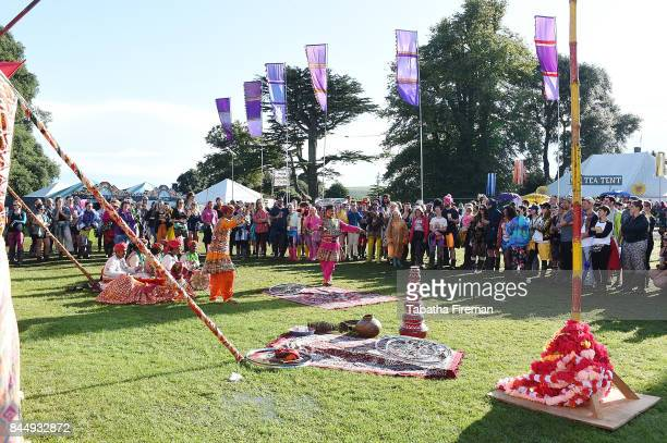 A happy audience of festival goers watch Circus Raj perform as the sun finally shines down on Day 3 of Bestival at Lulworth Castle on September 9...