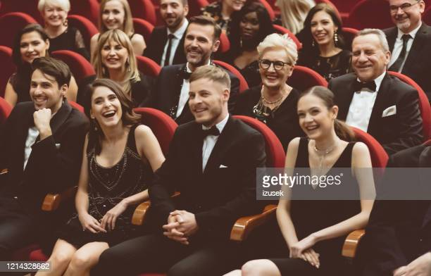 happy audience sitting in opera house - gala stock pictures, royalty-free photos & images