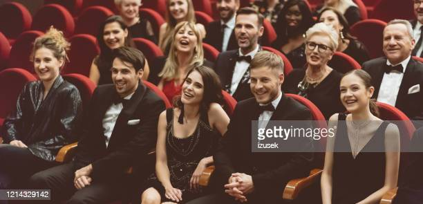 happy audience sitting in opera house - audience stock pictures, royalty-free photos & images