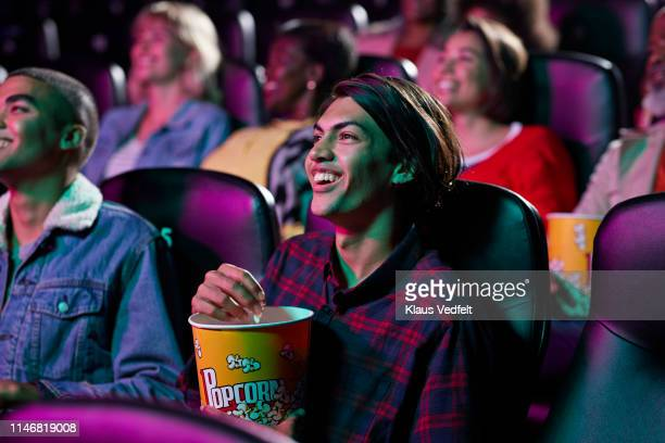 happy audience watching movie in cinema hall - film industry stock pictures, royalty-free photos & images