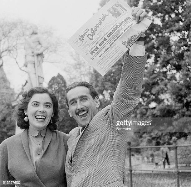 A happy Austrian couple Hans and Erna Steininger wave a newspaper announcing that the country is Free and Independent after the State Treaty was...