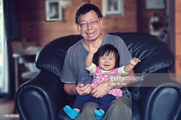 happy baby girl and grandfather - wellington new zealand stock photos and pictures