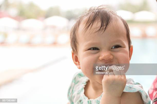 Happy baby girl eating pizza