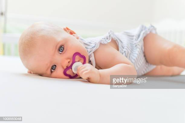 happy baby girl - pacifier stock pictures, royalty-free photos & images