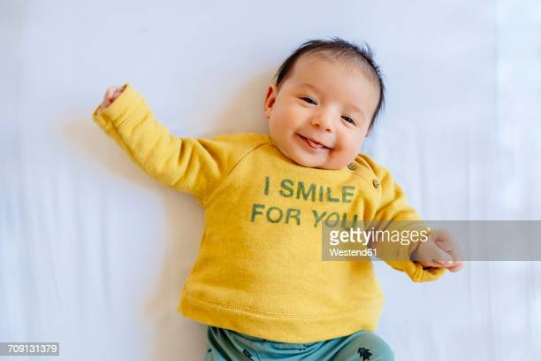 Happy baby girl smiling on the bed