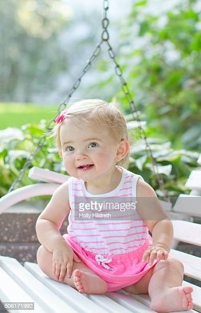 Happy baby on a swing