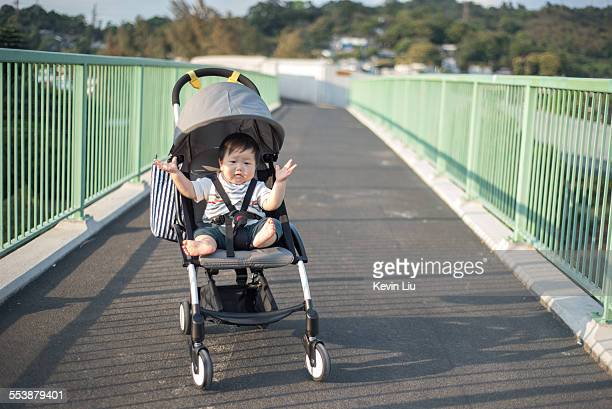 Happy baby on stroller