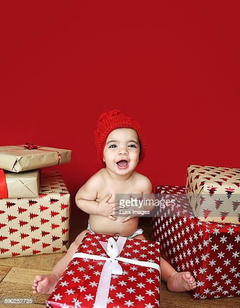 Happy baby opening presents