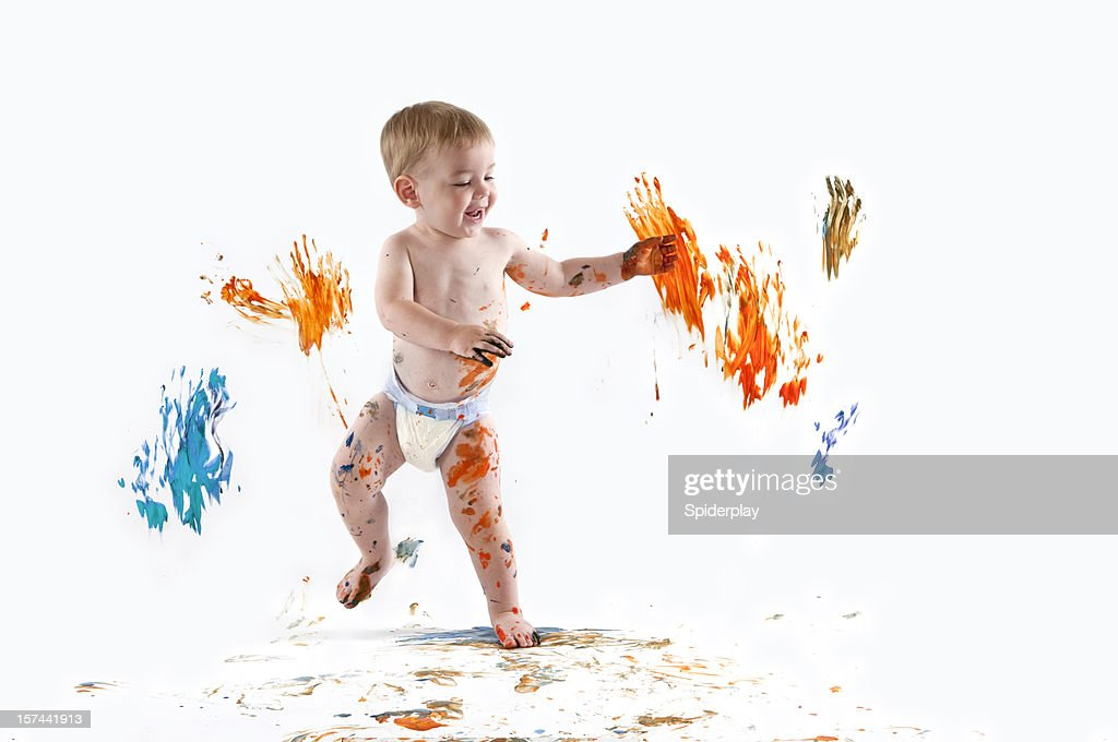 Happy baby painting with his hands : Stock Photo