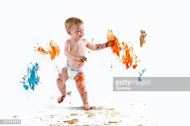 happy baby painting with his hands - diaper boy stock photos and pictures