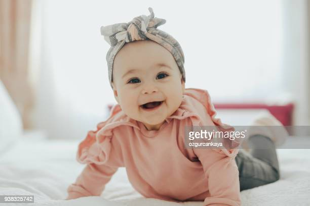 happy baby - baby girls stock pictures, royalty-free photos & images