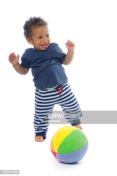 Happy Baby Smiling While Playing Football