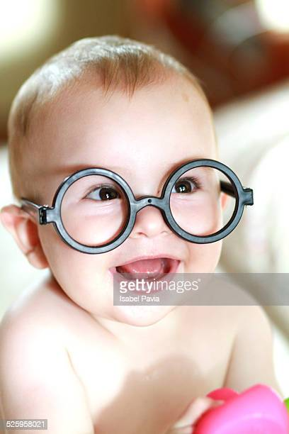 Happy baby with black glasses